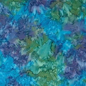 Mottled blue mixed with green and purple batik cotton fabric. Available at Colorado Creations Quilting