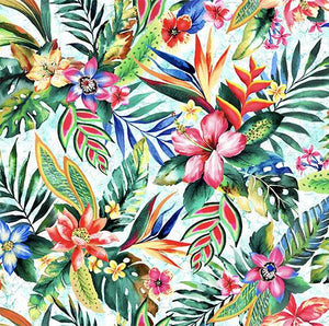 This cotton fabric features brightly-colored images of tropical flowers such as hibiscus, bird of paradise and plumeria on a light blue background. Available at Colorado Creations Quilting