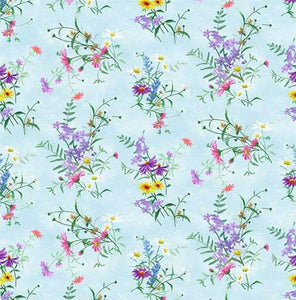 Dainty wildflowers of purple and yellow on a light blue background. Available at Colorado Creations Quilting