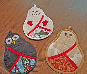This set of pot holders is a one-of-a-kind set that includes a snowman a gingerbread man and penguin.  Available at Colorado Creations Quilting