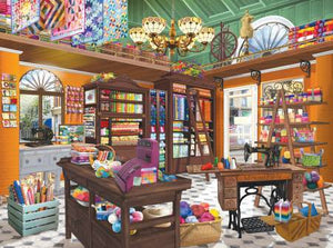 "This jigsaw puzzle by SunsOut in Puzzles and Games item #31526 has 1000 pieces and features aroom with an old treadle sewing machine, brightly-colored hanging quilts,bolts of fabric and spools of thread. Finished size 20"" x 27"""