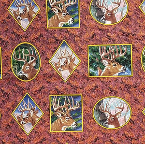 Elk portrait vignettes are portrayed in geometric shapes on a background of fall foliage cotton fabric.