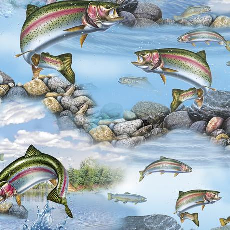 This fabric features rainbow trout jumping out of the stream looking to grab that fly. Available at Colorado Creations Quilting