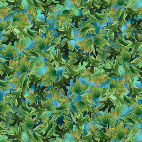 This cotton fabric features green leaves on an aqua blue sky. Available at Colorado Creations Quilting