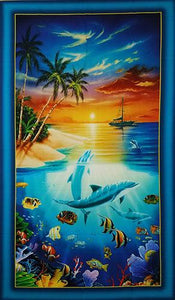 Imagine yourself sitting at the ocean's edge watching these playful dolphins  under the setting sun in a sky of oranges and gold.  Add to that image sail boats, palm trees and tropical fish and you've got a splendid fabric panel that's available at Colorado Creations Quilting