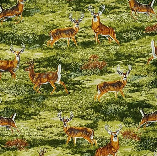 White-tailed deer in a green meadow gaze at you cotton fabric is available at Colorado Creations Quilting