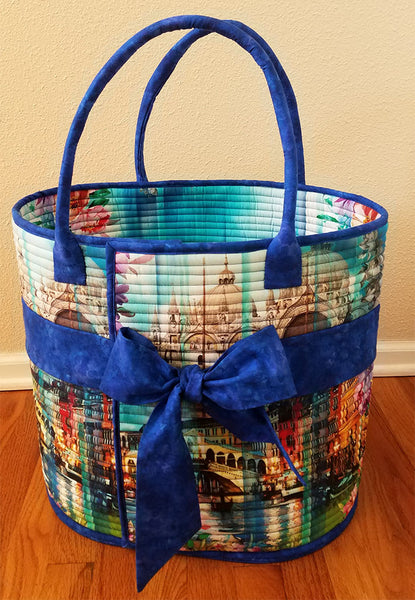 Rockport Carryall bag by Aunties Two available at Colorado Creations has an image of Venice on the bag with blue handles and a  large ribbon