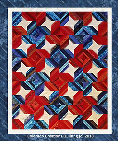 Stars and Strips quilt has cream stars surrounded by bands of red and blue available at Colorado Creations Quilting