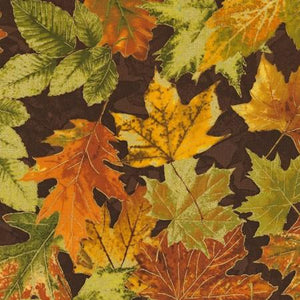 Large fall leaves in gold, rust and green on a brown background available at Colorado Creations Quilting