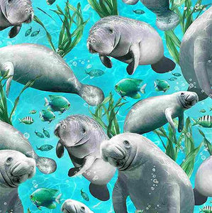 This cotton fabric features gray manatees on a rich turquoise background. Available at Colorado Creations Quilting
