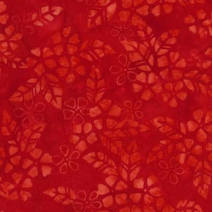 A scarlet red tonal fabric featuring blooming flowers. Available at Colorado Creations Quilting