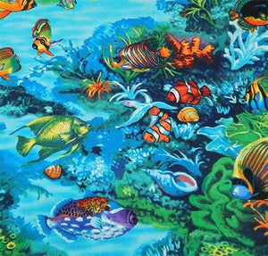 This cotton fabric features tropical fish swimming in turquoise blue water among coral and seashells along the sea floor.  Available at Colorado Creations Quilting