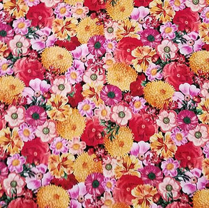 Multiple packed flowers in pinks, yellows, orange and red are featured in this Timeless Treasures fabric.