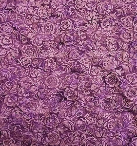 A purple tonal fabric featuring  large flowers. Available at Colorado Creations Quilting