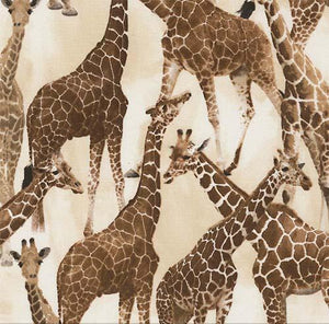 This cotton fabric features giraffes on a tan background.