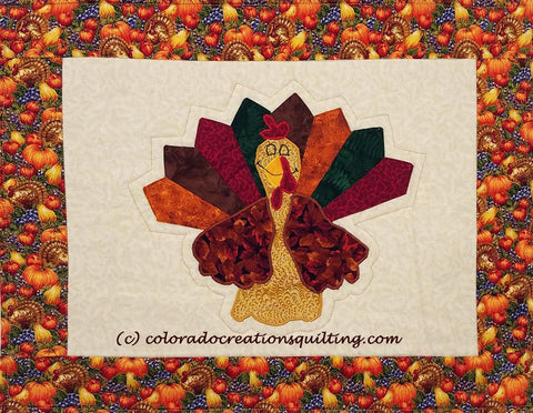 Appliqued turkey on cream colored placemats