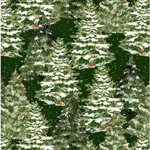 This cotton fabric features snow-covered fir trees on a green background. Available at Colorado Creations Quilting