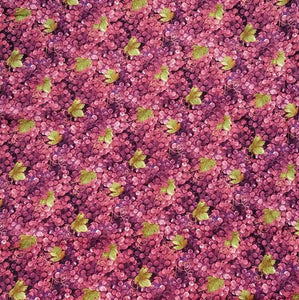 This cotton fabric features purple grapes with a few green grape leaves.
