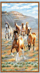 Wild stallions gallop across the open plains with blue skies with mountains in the background. It's sure to please the animal lover in your life.Available at Colorado Creations Quilting