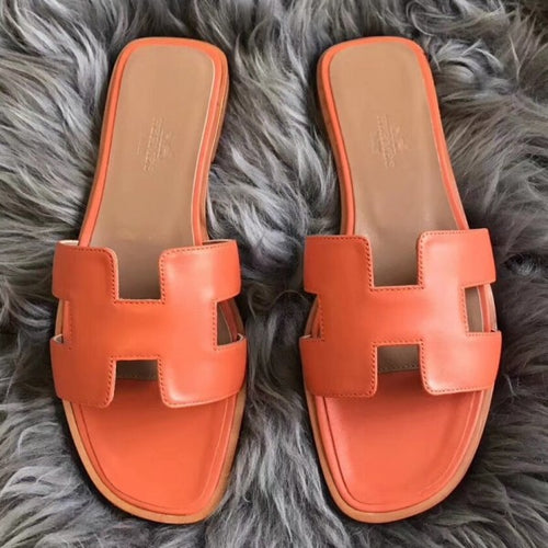 Hermes Oran Sandals In Orange Swift Leather