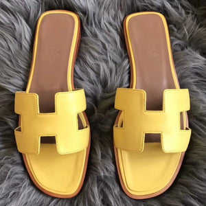 Hermes Oran Sandals In Yellow Swift Leather