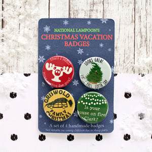 A set of four Christmas Vacation badges