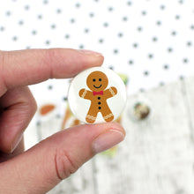 Load image into Gallery viewer, A gingerbread man with icing decorations