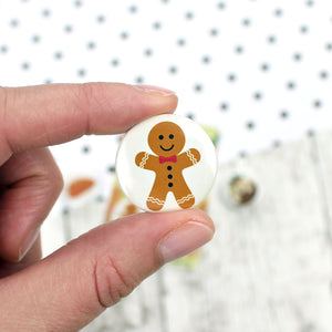 A gingerbread man with icing decorations