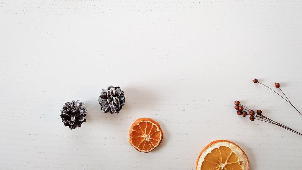 Christmas decorations of dried oranges and painted pine cones