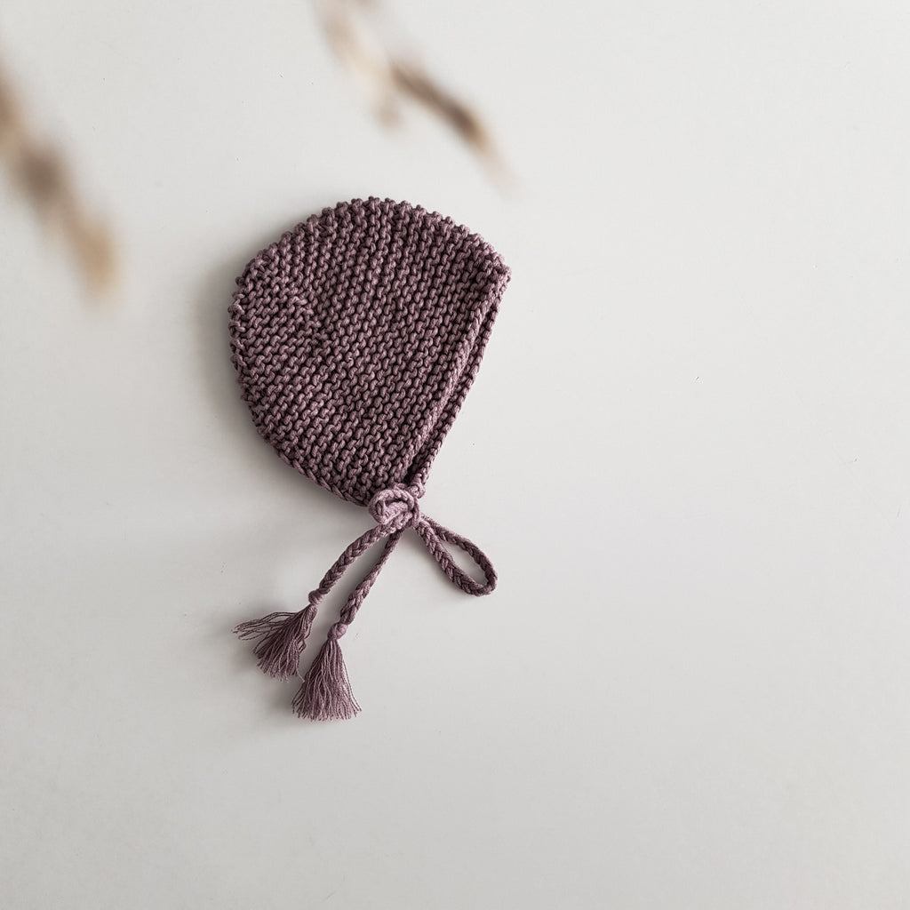 Knitted bonnet for baby doll, mauve