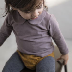 Toddler wearing a cute outfit featuring Crinkled effect baby bloomers by  sustainable kidswear brand Phil&Phae