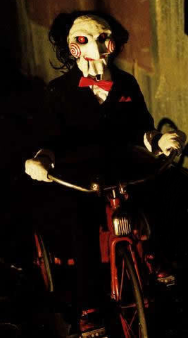 Billy the Puppet, from SAW, on a Tricycle