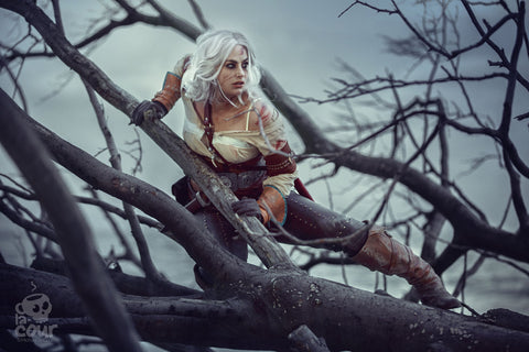 Meagan Marie dressed up as Ciri, in a foggy wooded area in Denmark