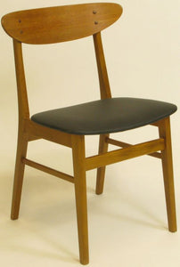 Danish chairs in teak with new leather.