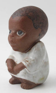 "Syd a Lisa Larson figurine in the series ""Children of the World"" by Gustavsberg. H: 10"