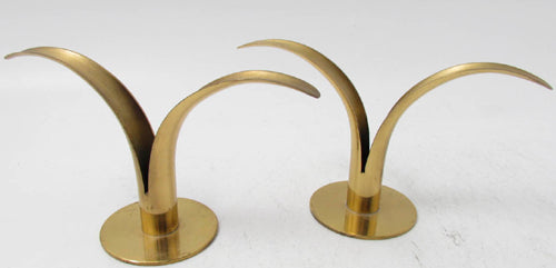 Candle sticks in brass by Ystad Metall.