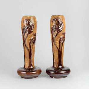 "Vaser jugend, av Karl Holst för Höganäs. 29 cm höga, nagg. Signerade Höganäs KH. 1975 kr/st. Art Nouveau vases by Karl Holst for Höganäs. H: 29cm/11,4"", chip. Signed Höganäs KH. SEK 1975/each"