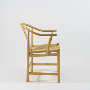 "Kinastolen pp66 i ask, och sits i pappersgarn. Hans Wegner för PP Möbler. H: 79cm, B: 58cm, D: 57cm. 16900 kr/st The Chinese chair, in ash and woven paper cord seat. Hans Wegner for PP Möbler. H: 79cm/31,1"", W: 58cm/22,8, D: 57cm/22,4"". SEK 16900/each"