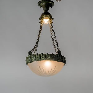 Jugendtaklampa i patinerad brons från Böhlmarks, 1910-tal. 60cm hög och diam. 35cm. An art nouveau ceiling light in bronze. Made by Böhlmarks around 1910. H: 60cm/23,6″ and diam. 35cm/13,8″