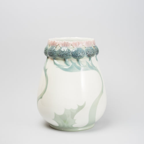 Jugendvas i underglasyrteknik. Karl Lindström för Rörstrand ca 1910. Signerad KL Rörstrand. 23,5cm hög. Art Nouveau vase in underglazed porcelain by Karl Lindström for Rörstrand, around 1910. H: 23,5cm/16,7″