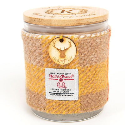 Grapefruit Scented soy candle with harris tweed sleeve