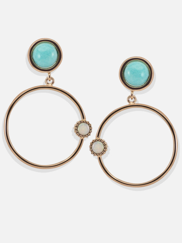 Inspired by satellites orbiting around their star, these hoop earrings are made with vibrant amazonite and glittering opal stones that are carefully handset in 18k rose gold over sterling silver. Handcrafted in our workshop in Italy, they will look just as chic with your daytime outfit as they will do with your eveningwear.