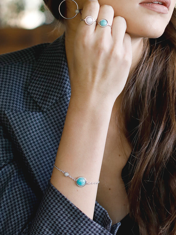 Amazonite for positive energy. Vibrant and full of style, our Satellites collection brings semi-precious gemstones to life for a fresh everyday look. This bracelet features Amazonite and Opal stones set in sterling silver. The chain size is adjustable.