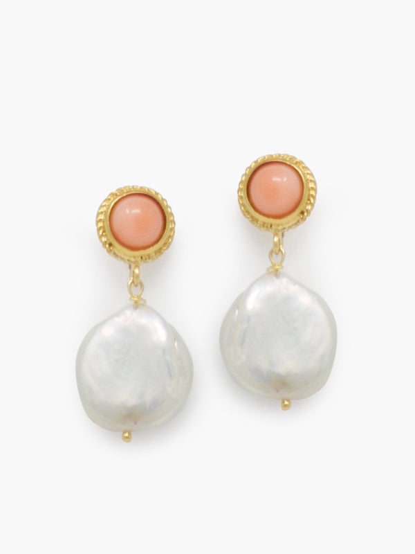 Jump into the summer trend with these stylish earrings, featuring two pink coral cabs tiered to keshi pearls.