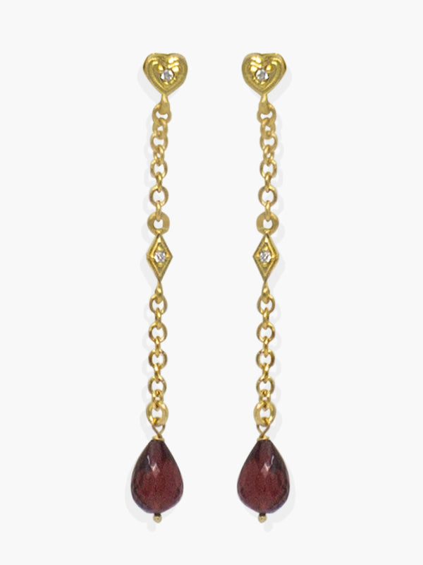 Here at Vintouch we're constantly focused on environmental sustainability, so we strive to craft our jewelry pieces from responsibly sourced materials. These earrings are inspired from Deco style jewelry, cast in our workshops in Italy from 18k gold-plated silver strung with faceted, ethically sourced garnet and AAA grade cubic zirconia that shimmer in the light. Featuring a dainty little heart stud that make them the perfect gift for someone you love.   Garnet is the birthstone for January.