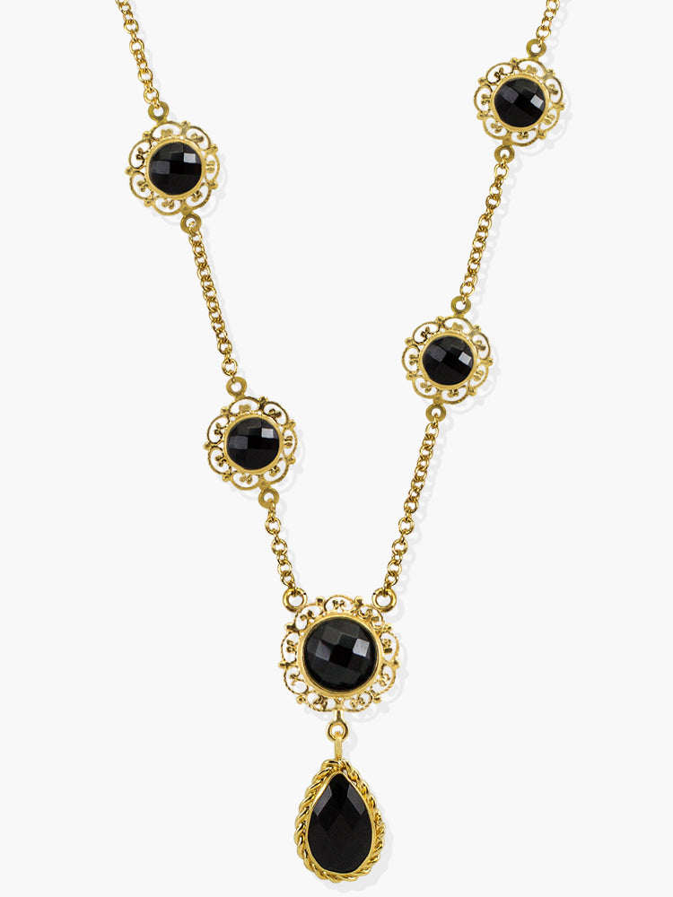 Inspired by the antique goldsmith technique known as 'Filigrana' - consisting in binding thin precious metal wires in order to create a pierced structure around the gemstone - the 'Taormina' necklace is handmade from 18-karat Gold Over Sterling Silver enriched by the vibrance of different sized and shaped onyx stones. Style this amazing necklace with your daytime tailoring or evening outfits either alone or stacked with the matching earrings.