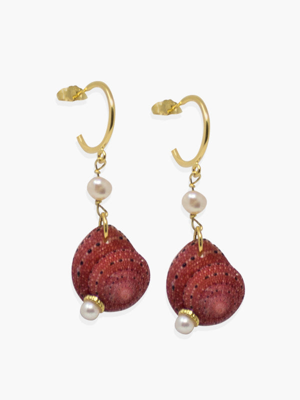 Stand out from the crowd with these elegant though unexpected mini hoop earrings featuring red Zanzibar shells dangling on a 18k gold over silver handmade hoops.