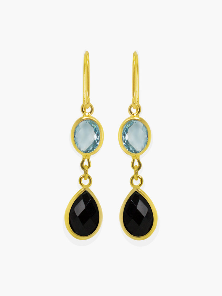Amalfi Drop Earrings by Vintouch Jewels, set with sky blue topaz and black onyx. Available either in 14k yellow gold or 18k gold plated silver.