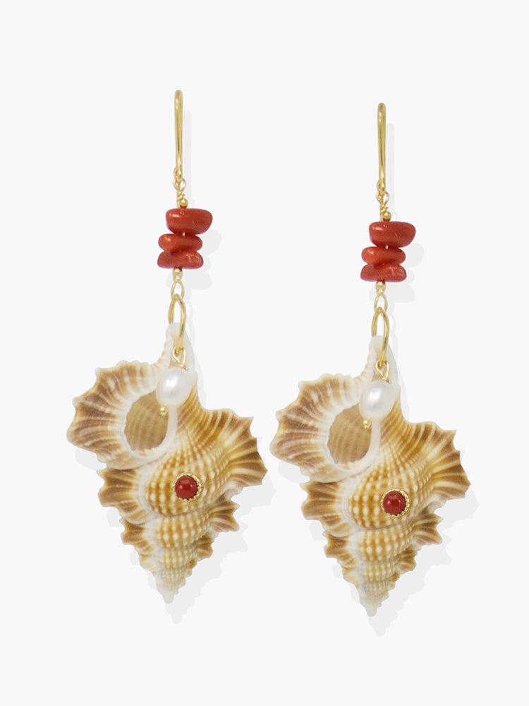 Featuring red coral and pearls, these earrings are cast from 18k gold over silver with a couple of cymatium shells whose shape reminds of Africa.