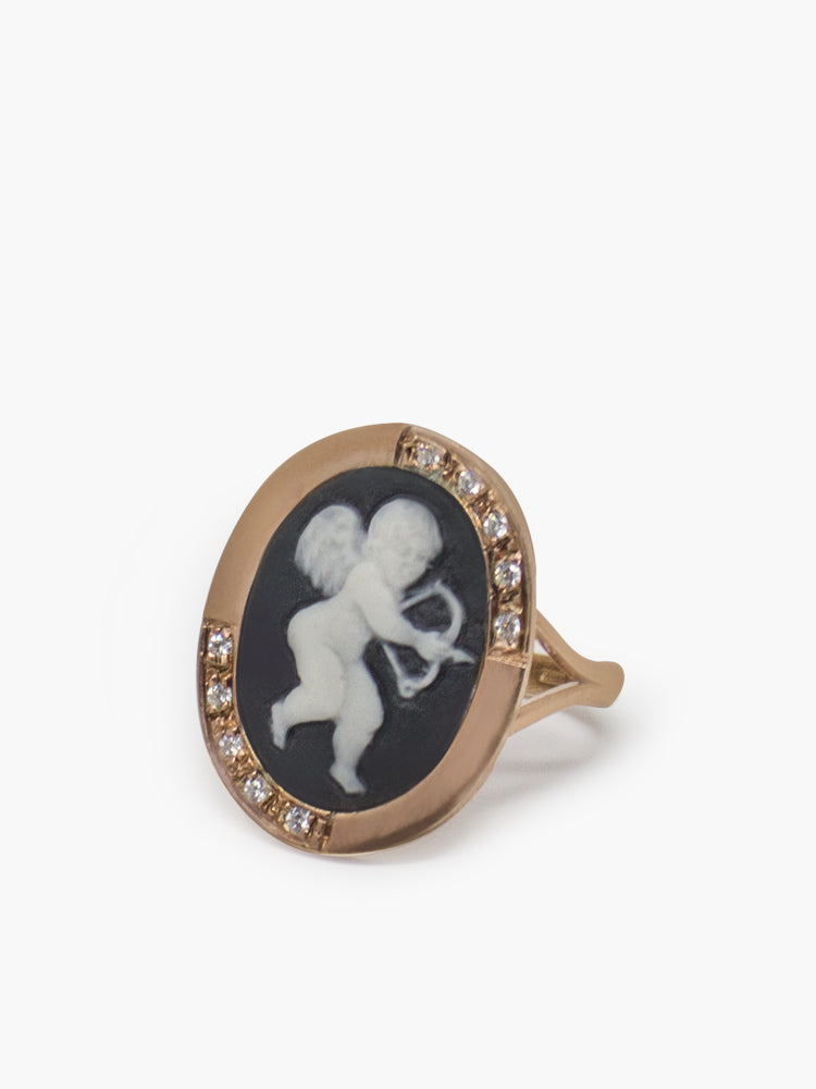 Cupid Cameo Ring by Vintouch Jewels, hand-carved from fine porcelain and bezel-set in 18k rose gold plated silver enhanced by white crystals.